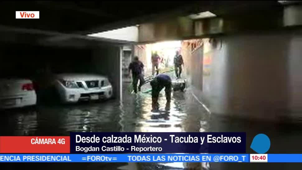 Lluvias inundan, estacionamiento, calle Esclavos, CDMX