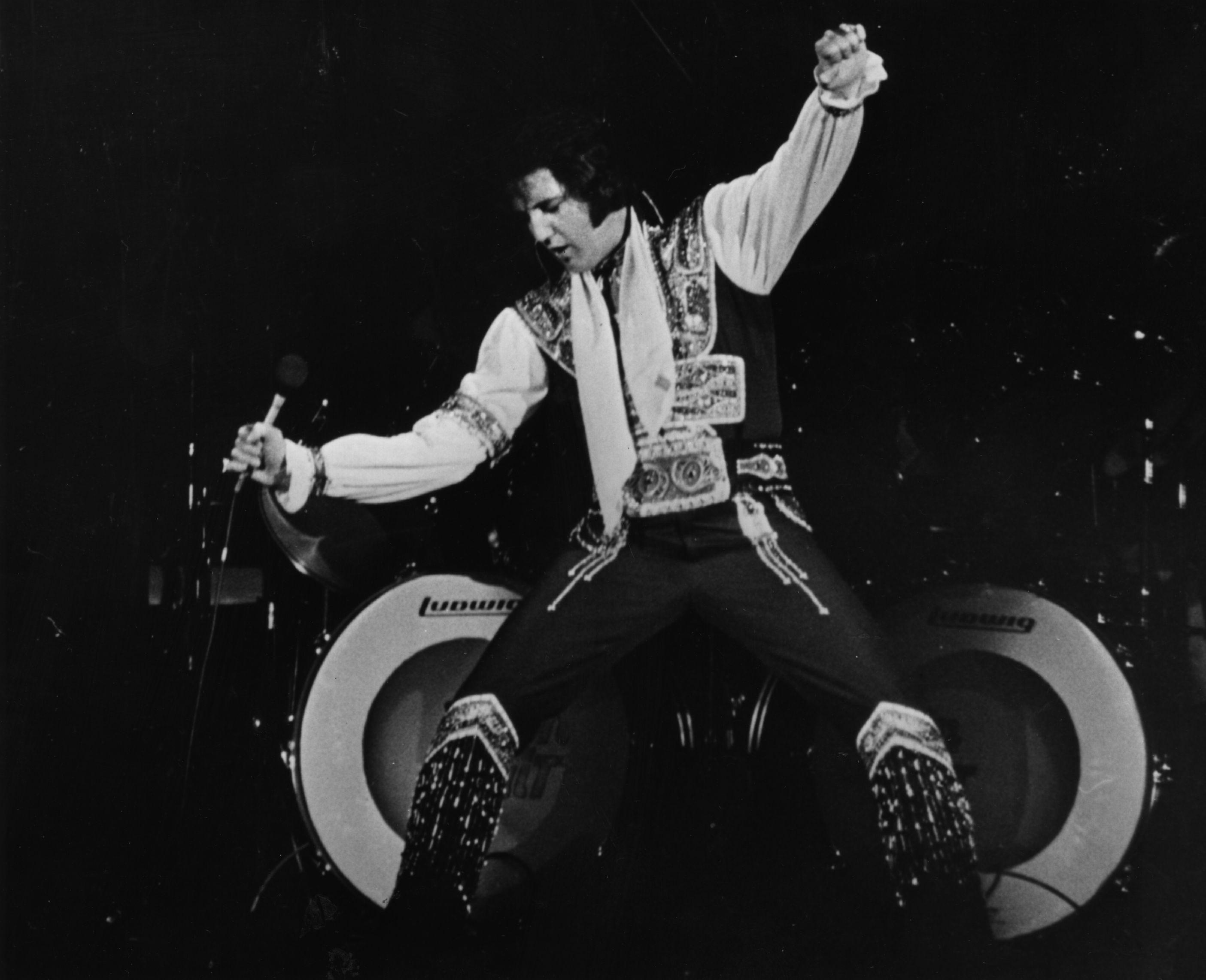 Elvis Presley reggaeton jóvenes música diablo