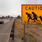 Letrero de cruce de migrantes