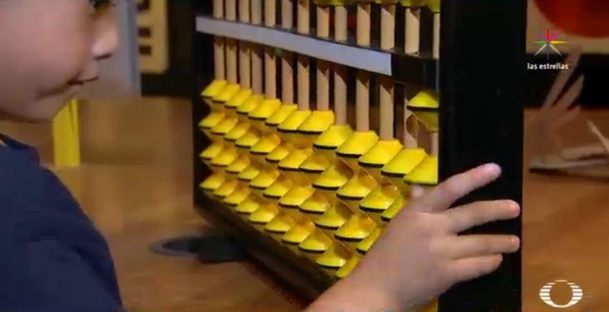 Ábaco utilizado por niños en el Método Aloha
