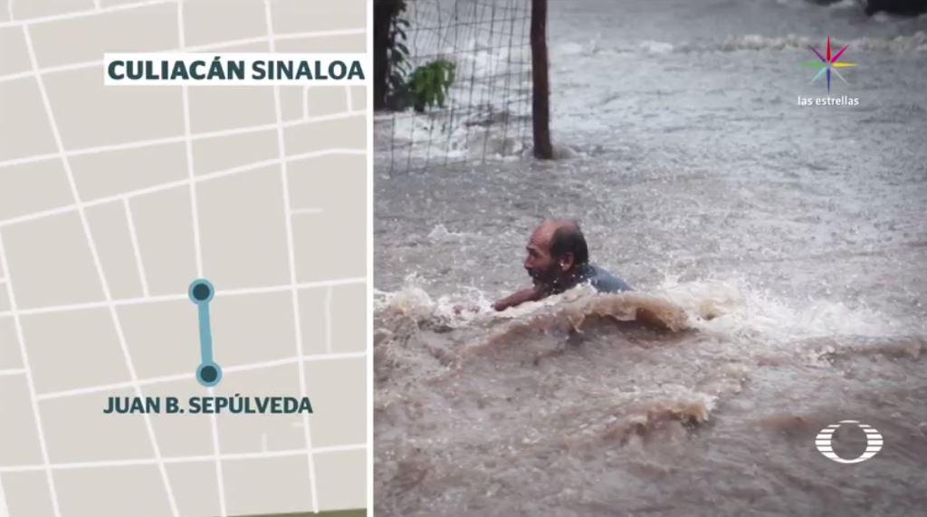 rescatan hombre arrastrado por caudal de agua culiacan
