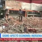 Damnificados de Juchitán tratan de recuperar materiales de entre los escombros
