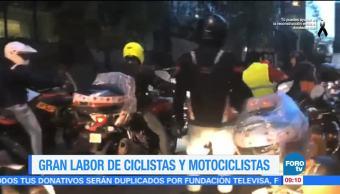 Gran labor de ciclistas y motociclistas