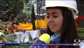 Mujeres se ponen cascos y botas para buscar a sobrevivientes del sismo
