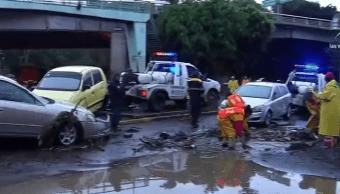 Coches afectados por inundación en Xochimilco, CDMX
