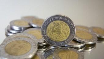 El peso mexicano pierde-mercado espera renegociación del TLCAN