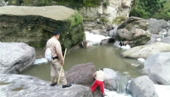 Recuperan cuerpo de menor que cayó a un canal en Guadalajara