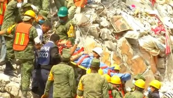 Rescatan persona viva y dos cuerpos en edificio Amsterdam en CDMX