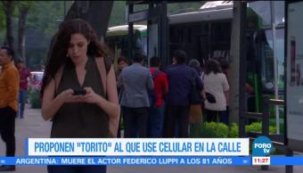 """Extra, Extra: Proponen 'Torito"""" al que use el celular"""