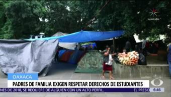 Padres de familia se enfrentan a CNTE por los derechos de estudiantes