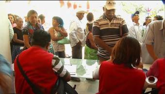 Siguen reclamos por clonación de tarjetas de ayuda a damnificados en Oaxaca