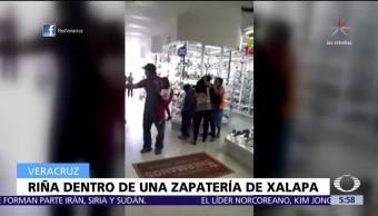 Mujeres protagonizan una riña en zapatería de Xalapa