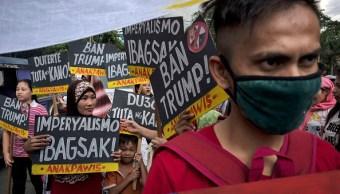 Protestan en contra de la visita de Donald Trump en Manila, Filipinas