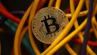 Moneda virtual Bitcoin rompe barrera 10 mil dólares