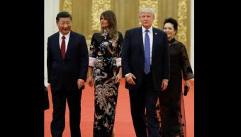 Xi Jinping y Donald Trump, acompañados por sus esposas. (EFE)