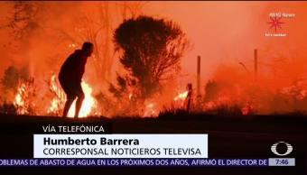 Bomberos combaten incendios de California por aire y tierra