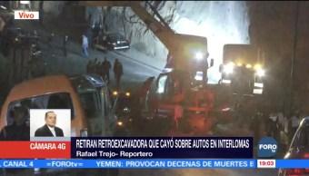Retiran retroexcavadora que cayó en Huixquilucan