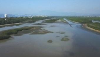 laguna del valle de las garzas en peligro por aguas negras