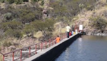 Mujer muere al caer en una presa de Aguascalientes