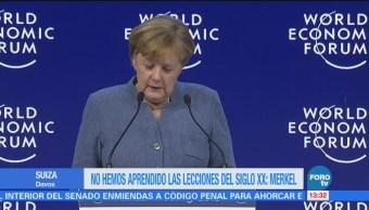 Angela Merkel y Emmanuel Macron participan en el Foro Económico Mundial