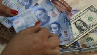 Dólar inicia el año a la baja en ventanillas bancarias