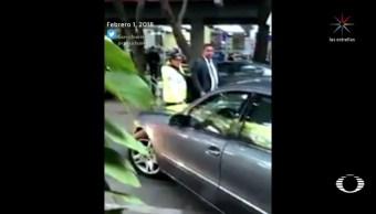 investigan agresion escoltas mujer policia transito