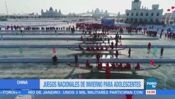 China realiza la carrera de botes llamada 'dragón de hielo'