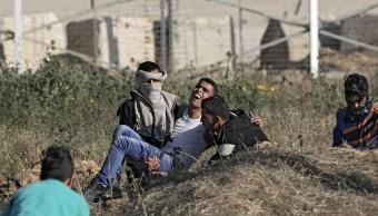 Protestas en Gaza dejan 13 palestinos heridos por balas israelíes