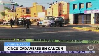 Encuentran cinco cadáveres dentro de auto estacionado en Cancún