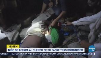 Niño se aferra al cuerpo de su padre tras bombardeo en Yemen