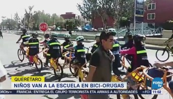 Niños van a la escuela en biciorugas en Querétaro