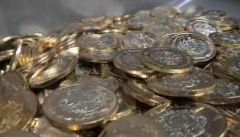 El peso mexicano se depreciaba el martes por tercer día consecutivo