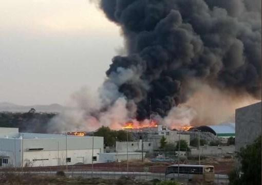 Suspenden clases en dos municipios de Hidalgo por incendio en tiradero