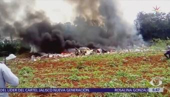 Llegan a México restos de víctimas de accidente aéreo