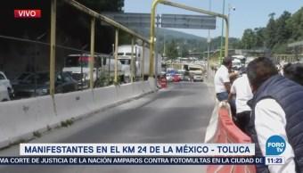 Transportistas se mantienen en el kilómetro 24 de la México-Toluca