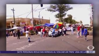 Conductor atropella a manifestantes durante bloqueo en Iztapalapa