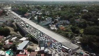 Bloquean Paso Exprés de Cuernavaca en memoria de víctimas
