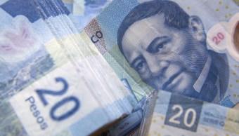 Peso mexicano se aprecia 1.55%, cotiza a 19.65 por dólar