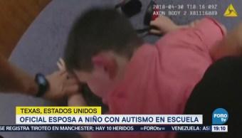 Policía esposa niño autismo escuela EU