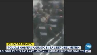Policías golpean a sujeto en la Línea 2 del Metro