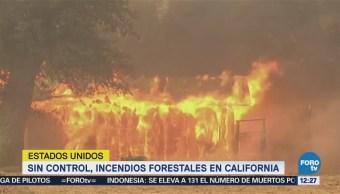 Siguen sin control los incendios forestales en California