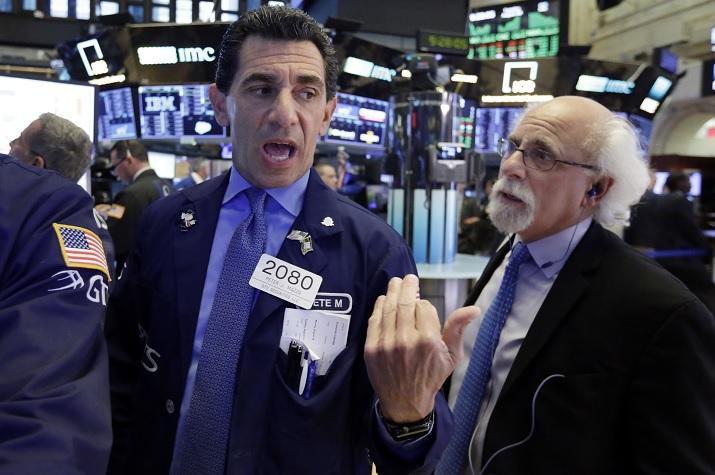 Wall Street cierra con ganancias y con récords