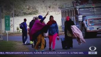 Los caminantes, refugiados de Venezuela que cruzan fronteras a pie