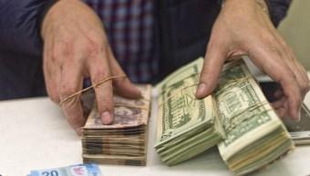 Peso mexicano se aprecia, espera publicación de TLCAN