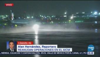 Reanudan operaciones en AICM tras fuerte lluvia