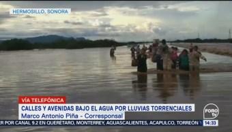 Vialidades inundadas por lluvias en Sinaloa y Sonora