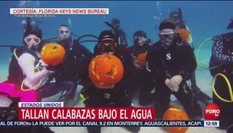 Buzos esculpen calabazas bajo el agua para Halloween