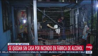 Vecinos de Atlampa se quedan sin casa por incendio en fábrica de alcohol