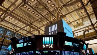 Wall Street abre mixto ante un menor crecimiento global