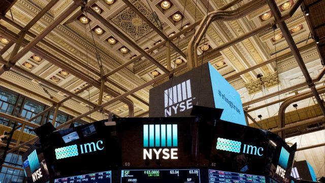 Wall Street abre mixto ante un menor crecimiento global
